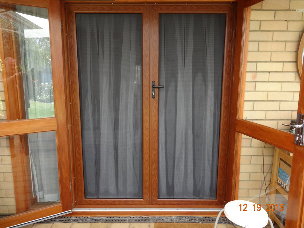 Security french hinged screen doors woodgrain finish for Security doors for french doors